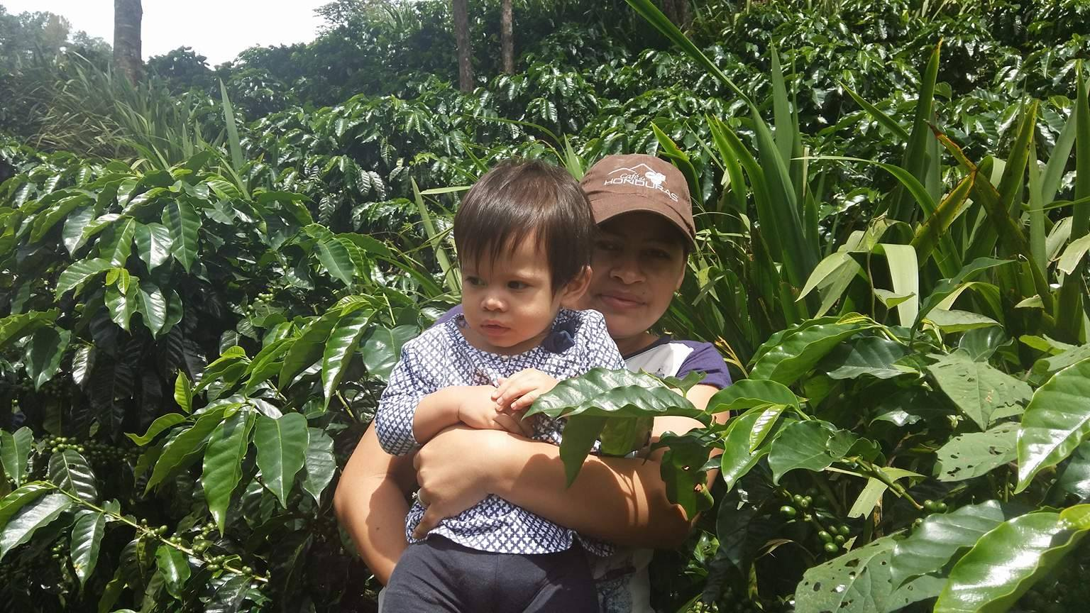 Elsy and her 4 year old son on the farm