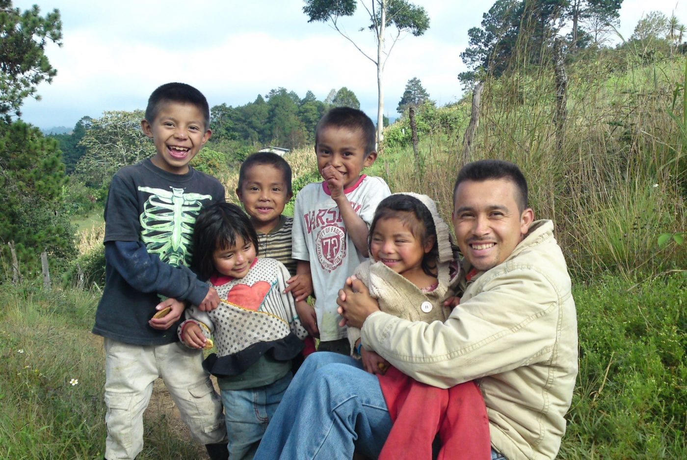 Manuel with his children on the farm